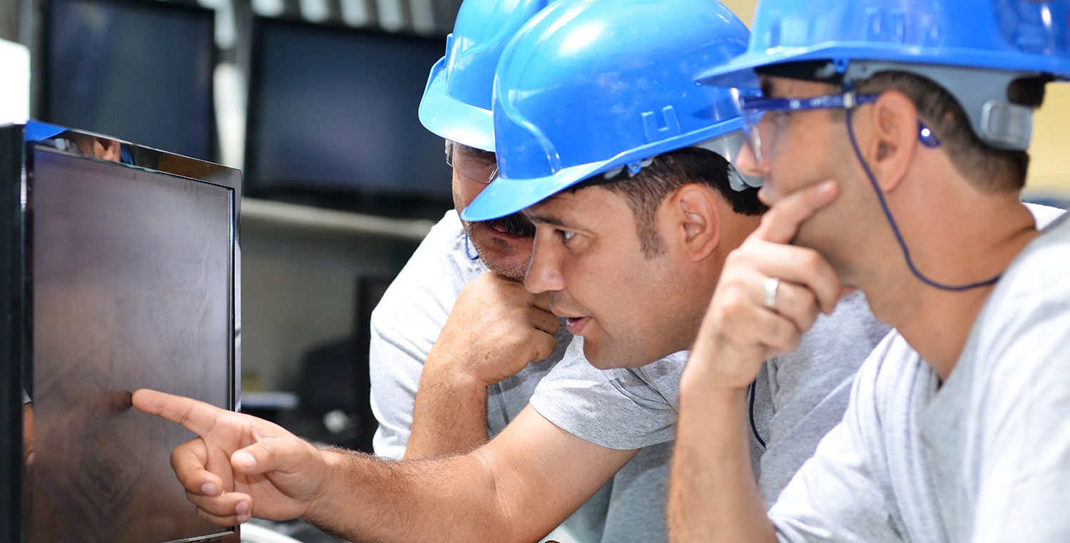 Workers are checking factory map